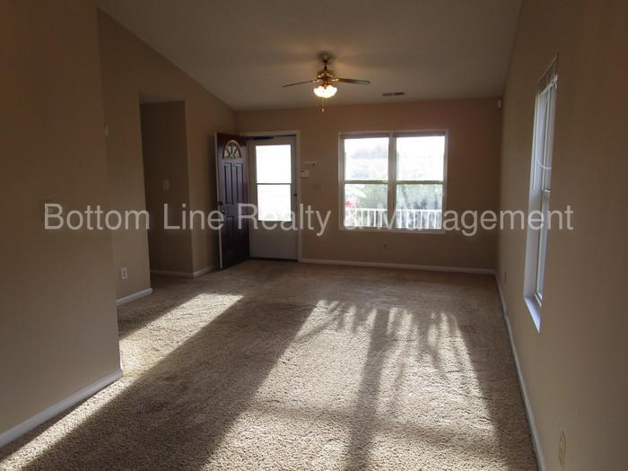 Three BR Two BA home with refreshed flooring and paint throughout.