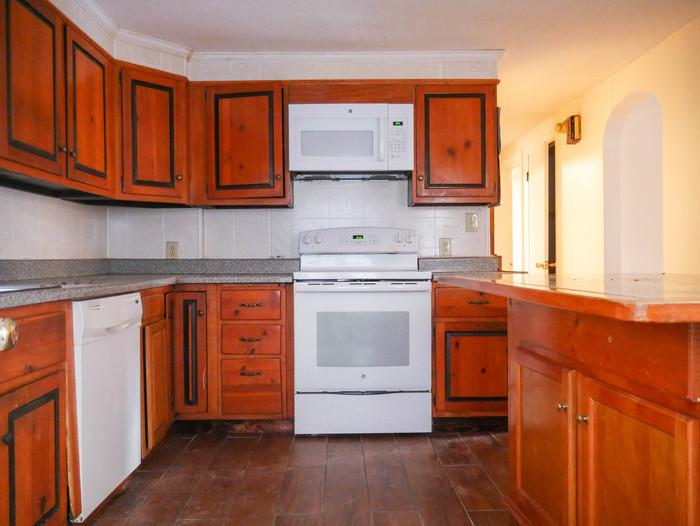 Located on a quiet this single family home is a keeper. Washer/Dryer Hookups!