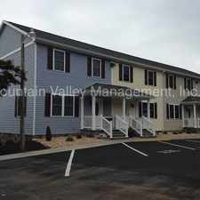 Rental info for Deluxe Town Homes, spacious rooms, upscale features.