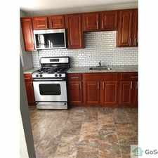 Rental info for charming renovated end of unit townhome with large side yard. in the Parkside area